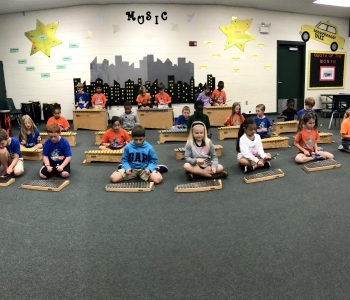 Students in Music class playing xylophone