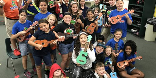 Students holding their Ukes